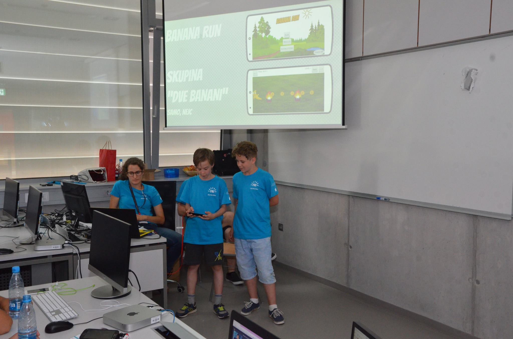 Kids presenting their app at AppInventor Summer School.